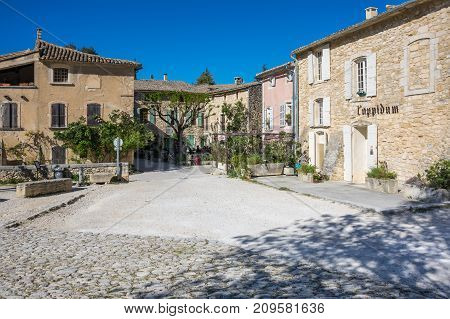 OPPEDE-LE-VIEUX FRANCE - APRIL 27 2016: Street of town Oppede-le-Vieux in Provence France