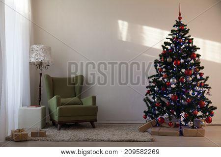 rozhestvenskaja tree in a white room on new year's Eve