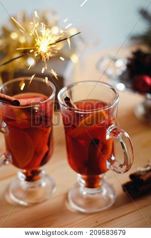 Beautiful Christmas Mulled Wine In A Glass In Decorating  New Year Interior Background
