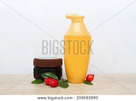 Two jars of cream and berries. daily care
