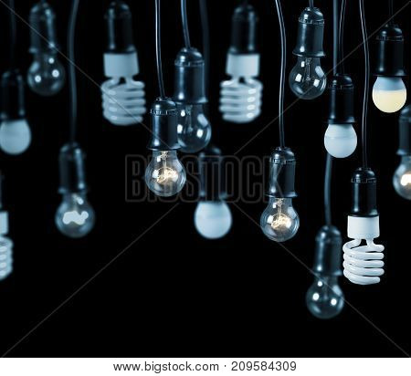 group of electric lamps in receptacle isolated on black background