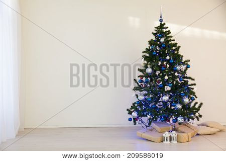 Christmas tree on Christmas day in a white room with gifts 1