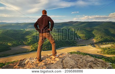 silhouette of man on top of mountain. Conceptual scene.