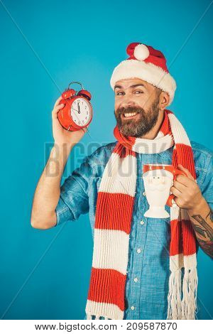 Christmas Hipster In Santa Hat, Scarf Smile On Blue Background