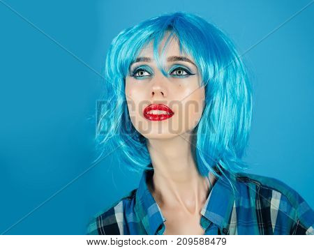Woman in blue wig with fashionable makeup. Girl with bright artificial hair. Beauty and fashion. Hairdresser salon and barbershop. Fashion model in checkered shirt and red lips.