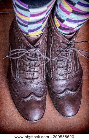 Young with vintage socks and shoes, conceptual image