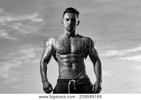 Sexy Muscular Man On Sky Background