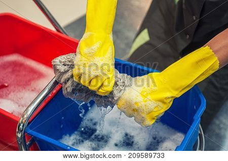 Cleaning concept. Closeup photo of woman cleaning shopping center