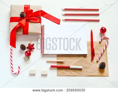 Top view of office supplies and christmas decoration6 writing a letter.