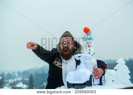Excited Hipster On Winter Landscape