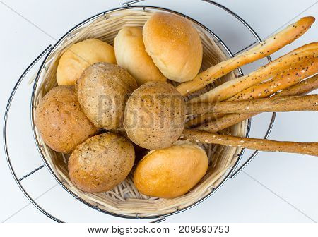 Bread assortment in food basket on white background