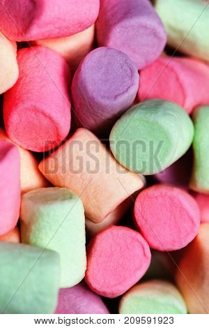 Colorful marshmallows as background macro. Fluffy marshmallows texture or pattern close up.