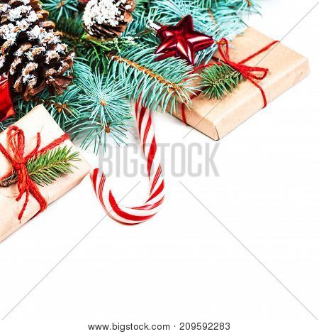 Christmas or New Year decorations background with pine cones fir branches and gift boxes isolated on white. Vintage Merry Christmas concept. Flat lay top view