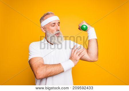 Cheerful Excited Mature Modern Macho Goofy Cool Pensioner Grandpa Practising Bodybuilding, Exercisin