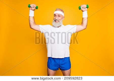 Body Care, Hobby, Weight Loss Lifestyle. Cheerful Cool Grandpa With Humor Grimace Exercising Holding