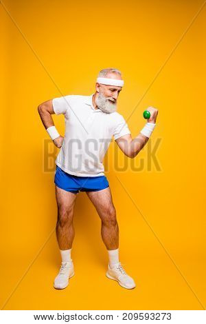 Cool Grandpa With Confident Grimace Exercising Holding Equipment Up, Lifts It With Strength And Powe
