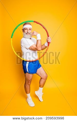 Cheerful Cool Excited Crazy Funny Fooling Playful Gymnast Grandpa With Comic Grimace Shows Off With