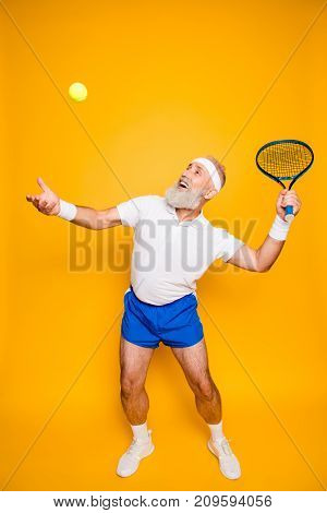 Competetive Emotional Cool Grandpa With Humor Grimace Exercising Holding Equipment, Swatting Ball Wi