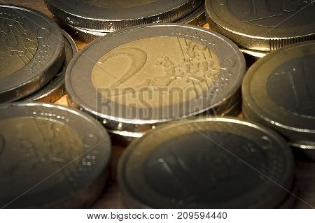 Two and one euro coin piles in pattern