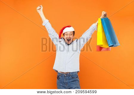 Excited Man Hands Up, Holding Packets, Scream Or Shout And Looking At Camera With Big Eyes And Open