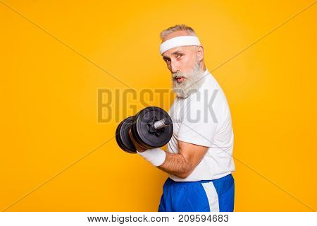 Cool Playful Flirty Naughty Strong Grandpa With Confident Grimace Exercising Holding Equipment Up, L