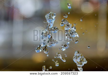 splash of crystalline water on a fountain drops of fountain water splash