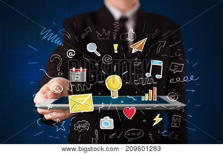 Businessman holding tablet with colorful apps
