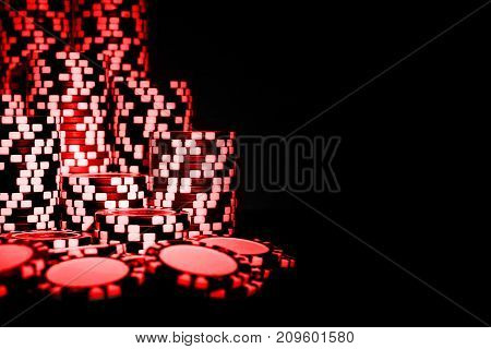 Stack of Red Poker chips isolated on a black background. poker table. Poker game concept. Playing a game with dice. Casino Concept for business risk chance good luck or gambling. chips for poker game