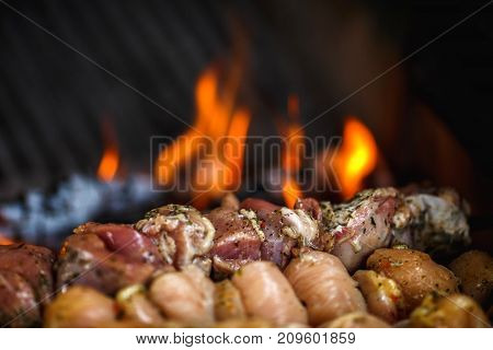 Barbecue BBQ roasted meat.  meat is frying on skewers on the grill on fire background. weekend picnic concept