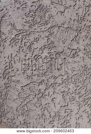 Gray rough surface of plastered wall as background