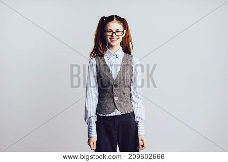 girl student with glasses smiling standing on white background
