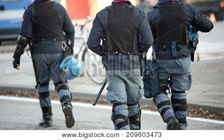 Policemen With Anti-bulletproof Jacket Patrol The Streets Of The
