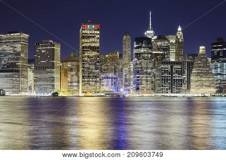 New York City Skyline Seen From Brooklyn At Night.
