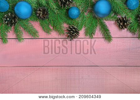 Christmas Background With Xmas Tree, Blue Ornaments, Pine Cones  On The Pink Background. Vintage Xma