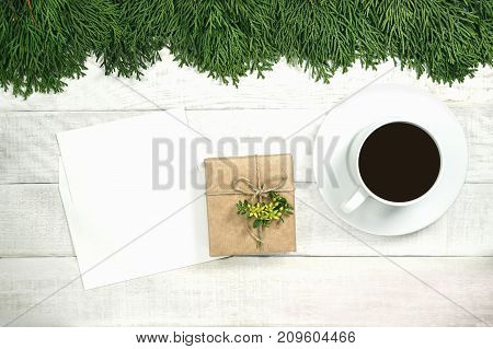 White Wooden Christmas Background. Border Decorated Thuja Branches. Copy Space For Holiday Greetings