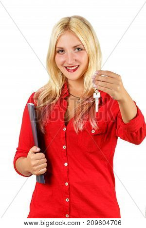 Smiling cute girl in red shirt holding the black folder and gives the key. Real estate car rental agent manager