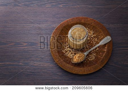 jar of homemade tahini with sesame seeds - food and drink