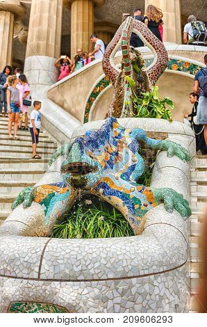 The Iconic Dragon Sculpture In Park Guell, Barcelona, Catalonia, Spain