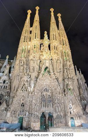 Nativity Facade Of Sagrada Familia By Night, Barcelona, Catalonia, Spain