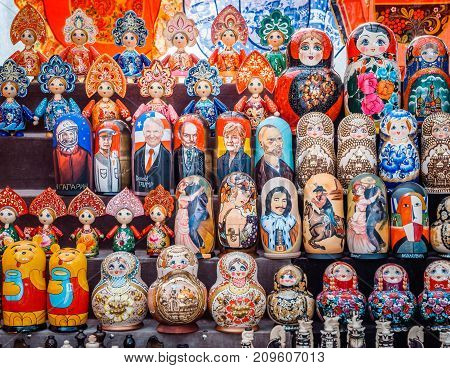 Uglich, Russia - 20 July 2017: Colorful Russian nesting dolls Matryoshka at the market. Russian Santa Claus Ded Moroz, different Policies ets.