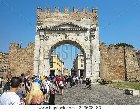13.06.2017, Rimini, Italy - Tourists Near Arch Of Augustus, Ancient Romanesque Gate Of The City