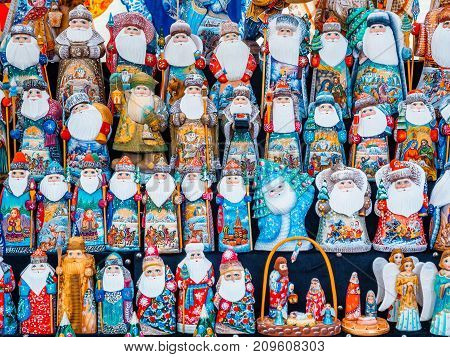 Uglich, Russia - 20 July 2017: Colorful Russian nesting dolls Matryashka at the market. Russian dolls are Santa Claus Ded Moroz Father Frost and Snow Maiden.