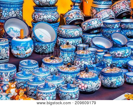 Uglich, Russia - 20 July 2017: Russian wooden utensils. Painted in khokhloma style. Traditional Russian souvenir. Kitchen Decor.