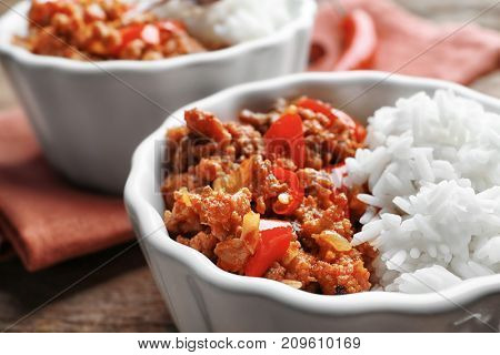 Chili Con Carne with rice in bowl, close up