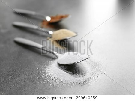 Different protein powders in spoons on table