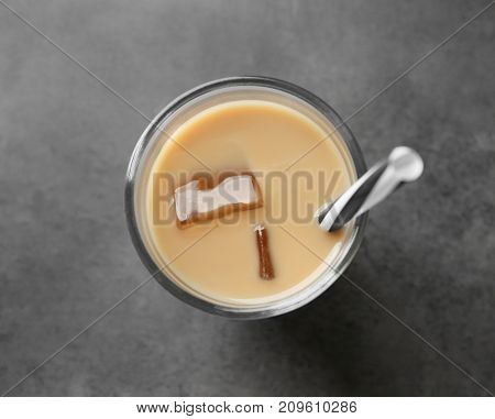 Glass with protein shake on table
