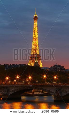 PARIS - 18 OCTOBER, 2017: Eiffel Tower in the Dusk on October 12, 2017. The Eiffel tower is the most visited monument of France located on Champs de Mars in Paris, France.