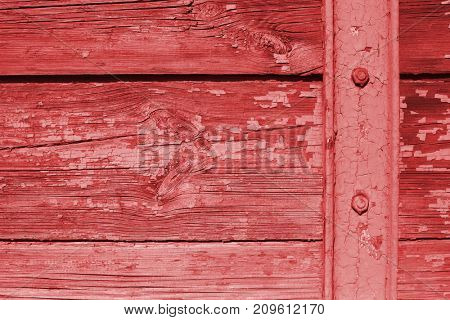 Wooden boards red color paint textured background.