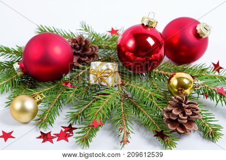 Christmas Tree with Cones border isolated on a White background. New Year holiday evergreen tree, Xmas green art corner design. Branches of fir tree decorated with holly berry and cones. Winter