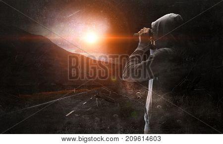 Guy in hoody looking in binoculars. Mixed media